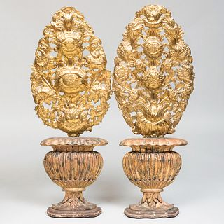 Pair of Continental Baroque Brass Repoussé Floral Sprays, Raised on Later Painted Urn Bases