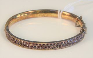 Two piece lot including a 10 Karat Bangle Bracelet set with garnets, in a box with Card of Hotel Palace, Praha  marked Prague on back, and a gold plat