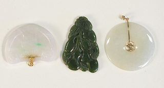 Three piece lot to include; Carved White Jade Pendant half oval with gold mount 54.85mm x 39.95mm carved white jade disc with gold mount and center go