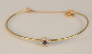 14K bracelet set with blue stone surrounded by eight diamonds. 5.4 grams Provenance: The Estate of Diana Atwood Johnson