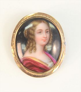 14 Karat Framed Brooch with painting on porcelain of a young woman length 1-1/4 inches