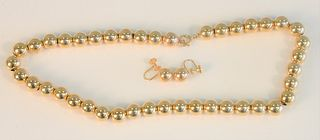 Three piece lot to include; 14K gold bead necklace and pair of earrings, screwbacks 17.6 grams, one small dent.