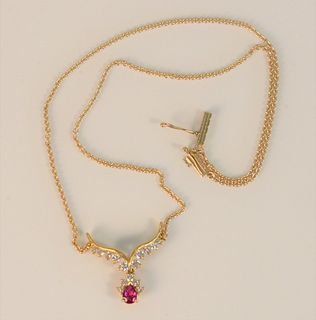14 Karat Yellow Gold Chain with Pendant set with ruby and fifteen diamonds length 14 1/2 inches 6.2 grams total weight Provenance: The Estate of Diana