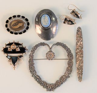 Seven Piece Lot to include three piece Victorian brooch and earring set along with hair brooch and three silver brooches one marked Stieff