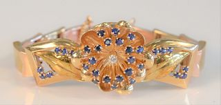 14 Karat Gold Bracelet having three dimensional flower with blue sapphires and diamond center with sectioned band length 6 1/2 inches, 37.8 grams tota