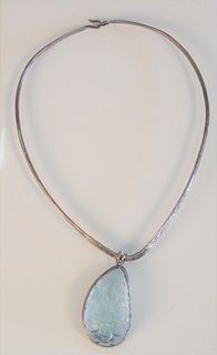 Designer Sterling Silver Necklace with large teardrop shaped carved light blue stone signed AB. 29.5 millimeters x 47 millimeters