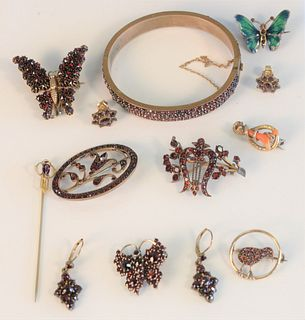 Nine Piece Victorian Lot all mounted in red stones, bangle bracelet, pins and earrings Provenance: From the Lance & Irma Keller Collection, Bloomfield