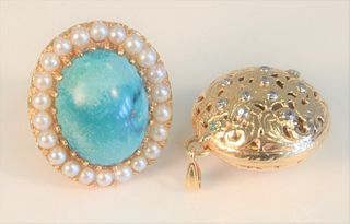 Two piece lot to include; one 14 Karat Gold Ring set with cabochon cut turquoise, surrounded by pearls, 13 grams total weight, along with one herb lo