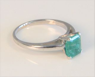 14 Karat White Gold Ring set with emerald cut emerald size 7 3/4, 3.2 grams, emerald 6 x 7.4 millimeters