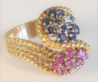 18 Karat Gold Ring rope design with blue sapphire head and ruby head size 7 3/4, 12.6 grams total weight Provenance: From the Lance & Irma Keller Coll