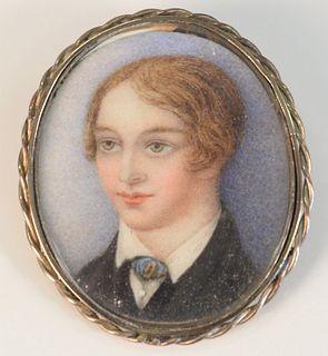 "Gold case pin having miniature portrait of a boy inside Length: 1-1/4"""