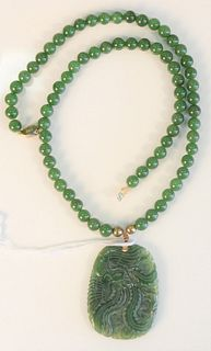 Green jade bead necklace with carved green jade pendant, necklace length 22 inches