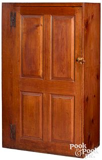 New England stained pine raised panel cupboard