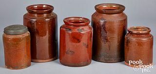Five redware crocks