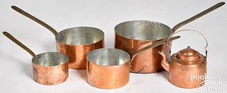 Nest of four dovetailed copper pots