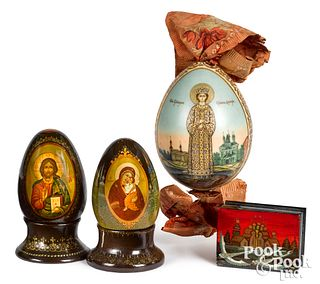 Three Russian painted eggs, together with a box
