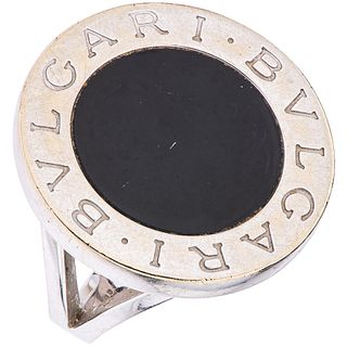 18K WHITE GOLD RING WITH ONYX, BVLGARI, BVLGARI BVLGARI  COLLECTION Shows wear. Weight: 15.1 g. Size: 7...