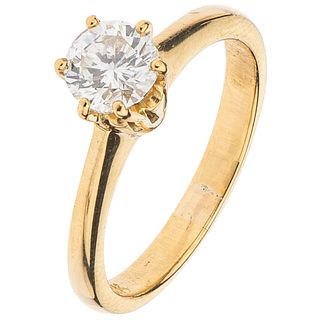 SOLITAIRE RING WITH DIAMOND IN 18K YELLOW GOLD Weight: 3.5 g. Size: 5 ½   1 Brilliant cut diamond ~0.56 ct ...