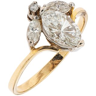 RING WITH DIAMONDS IN 10K YELLOW GOLD Weight: 2.0 g. Size: 7  1 Marquise cut diamond ~0.9...