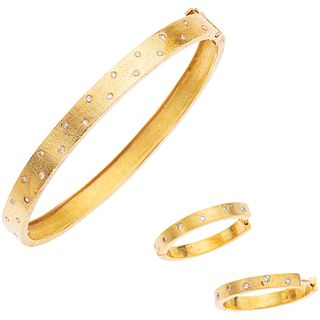 SET OF BRACELET AND PAIR OF EARRINGS WITH DIAMONDS IN 18K YELLOW GOLD Bracelet with box clasp and 8-shaped safety.