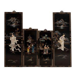 Lote de 4 paneles. SXX. Origen oriental. En madera laqueada. Decorados con aplicaciones de concha nácar y piedra jabonosa. 94 x 30 cm.