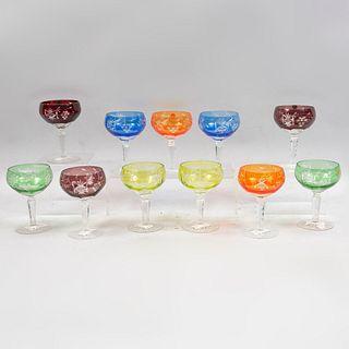 Lote de 11 copas. Polonia. Siglo XX. Elaboradas en cristal de Bohemia. Decoradas con elementos orgánicos, facetados, frutales.
