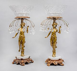 Par de fruteros. Siglo XX. Elaborados en metal dorado. Con depósitos superiores de cristal cortado y fustes antropomorfos. 60 x 30 cm