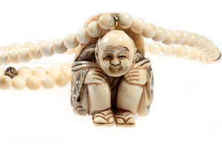 Chinese carved netsuke/pendant on beaded chain