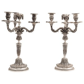 """PAIR OF CANDLESTICKS FRANCE, 20TH CENTURY Silver bronze, for three lights each, adaptable to a single light, 15.7"""" (40 cm) high"""