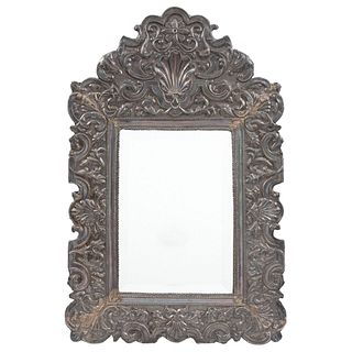 """MIRROR EARLY 20TH CENTURY Embossed silver frame, plant decoration Conservation details 27.9 x 17.7"""" (71 x 45 cm)"""