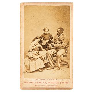 [SLAVERY & ABOLITION] -- [CHINN, Wilson]. PAXSON, Charles, photographer. Learning is Wealth. Wilson, Charley, Rebecca & Rosa. Slaves from New Orleans.