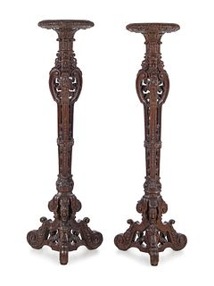 A Pair of Louis XIV Style Carved Oak Torcheres