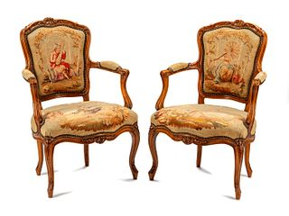 A Pair of Louis XV Tapestry-Upholstered Walnut Fauteuils