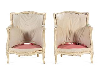 A Pair of Louis XV Carved and White-Painted Low Bergeres