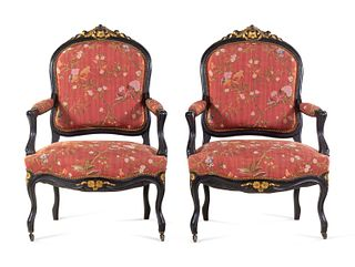 A Pair Louis XV Style Scalamandre Upholstered Parcel Gilt and Ebonized Fauteuils