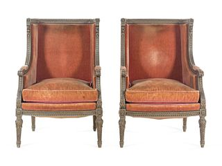 A Pair of Louis XVI Carved and Painted Walnut Bergeres a L'Oreilles