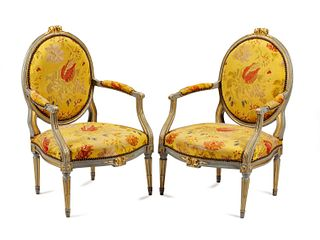 A Pair of Louis XVI Painted and Parcel Gilt Fauteuils