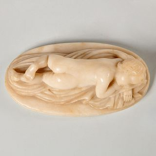 Alabaster carving of a young boy sleeping