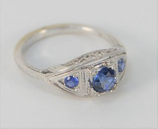 18 Karat White Gold Ring, set with three blue sapphires, center approximately .50 carats, size 5 1/2.