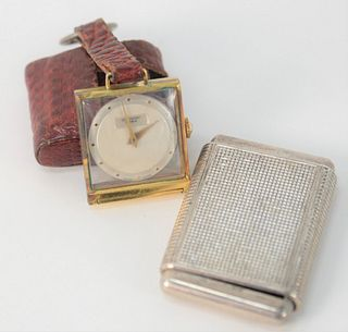 Two Small Travel Clocks by Jean Perret, in leather case, Cyma La Captive in silver case.