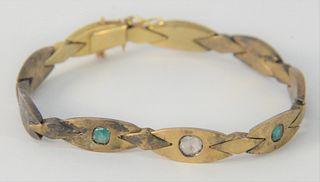 14 Karat Gold Bracelet, set with diamond and two emeralds, 15.7 grams.