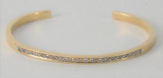 14 Karat Gold Bangle Bracelet, set with diamonds, 14.5 grams.