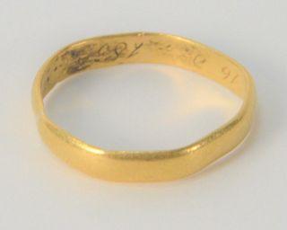 22 Karat Gold Band, dated 1852, bent, 4.1 grams.