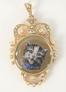 15 Karat Gold Medallion, with enameled cat, set with small pearls, height 1 7/8 inches, total weight 13.8 grams.