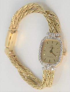 Omega 14 Karat Gold Ladies Wristwatch, with 14 Karat gold triple chain bracelet, total weight 20 grams.