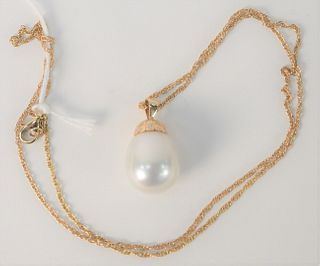 14 Karat Gold Chain, with long pearl, set with 14 karat gold and diamonds.
