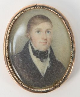 """Miniature Painting of a Gentleman, in a gold case with hair in back; pin missing 2"""" x 1 1/2"""". Provenance: From the Lance & Irma Keller Collection, Blo"""
