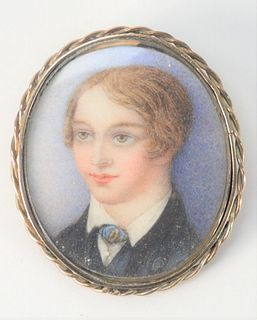 Gold Case Pin, having miniature portrait of a boy inside, length 1 1/4 inches.
