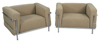 Pair of Le Corbusier Cassina LC2 Tan Upholstered Armchairs, with chrome base and supports, height 24 inches, width 38 inches.