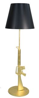 "Philippe Starck Lounge Gun Floor Lamp, in the form of a M16, gold diecast aluminum, titled ""Guns"", special edition, signed on base, height 67 inches."